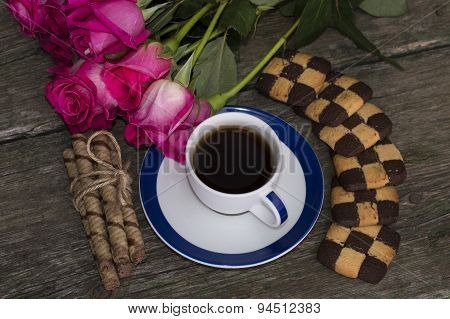 Cup Of Black Coffee Of A Rose And Cookies The Top View