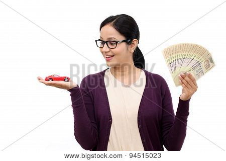 Young Woman Holding A Toy Car And Indian Rupee Notes