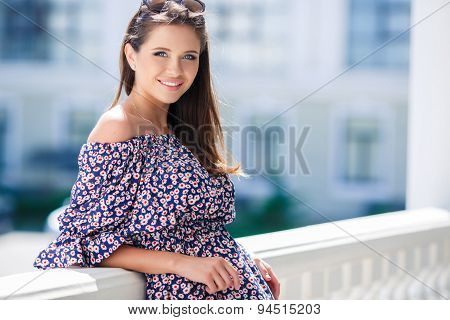Photo of a beautiful woman with long straight brown hair looking at camera