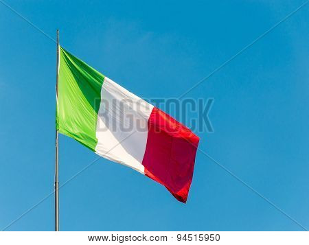 italian flag waving over a blue sky