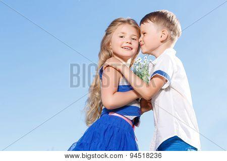 Positive little boy bonding to the girl