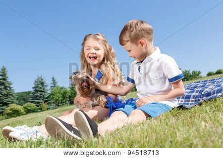 Positive children playing with dog