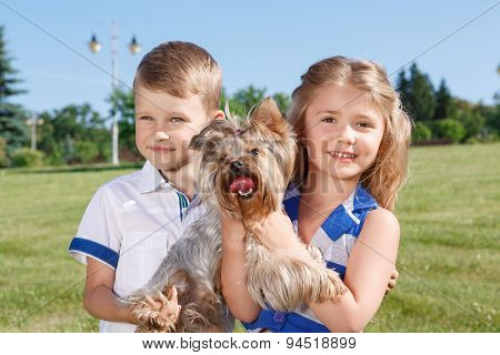 Vivacious children having fun with dog