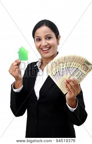 Young Business Woman With House Model And Indian Rupee Notes In Hands