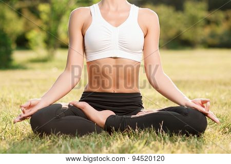 Pleasant young woman practicing yoga