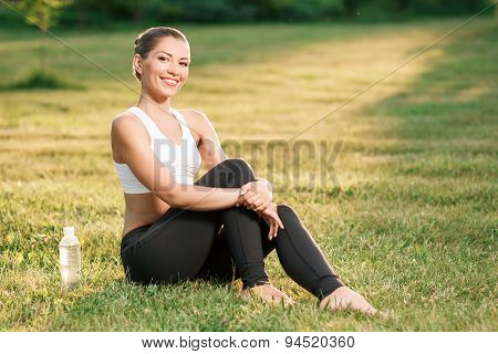 Young nice lady relaxing on grass