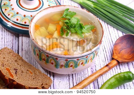 Soup With Pelmeni, A Potato, Carrots Submitted With A Green Onions And Pepper