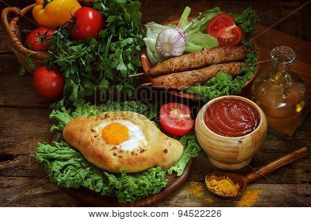 Open Pie With Egg, Barbecue Cutlets Submitted With Tomato Sauce, Vegetables And Greens
