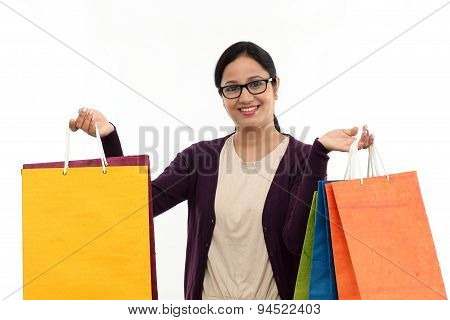 Young Cheerful Woman Holding Shopping Bags