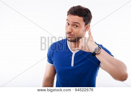 Attractive young guy is gesturing positively and nicely