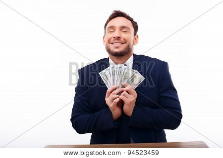 Attractive young guy is rich and happy