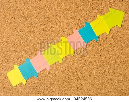 cork board colored diagonal arrows