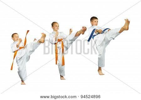 Mae-geri kick are beating three sportsman in karategi