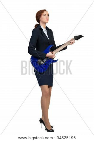 Businesswoman with guitar