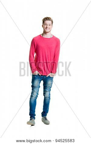 Teenage boy in a pink shirt and jeans isolated on white
