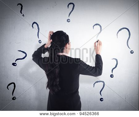 Business Woman Write Question Mark On The Wall