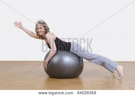 Woman Exercises With Pilates Ball