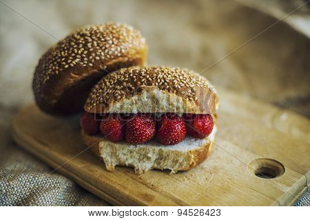 Breakfast With Berries And A Roll On A Wooden Board
