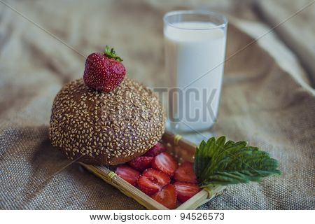 Breakfast Of Berries With A Bun And A Glass Of Milk