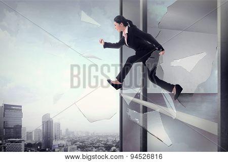 Business Woman Jump Through Office Window Glass
