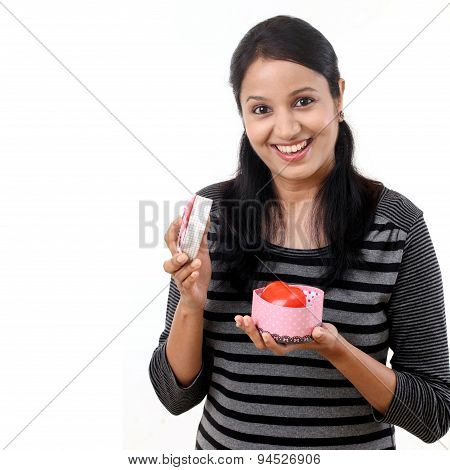 Young Happy Woman Opening A Gift Box
