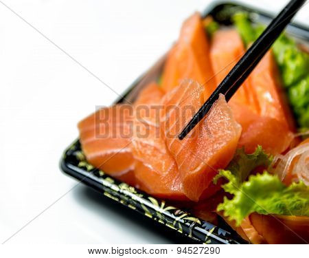 Salmon Sashimi Grab With Chopstick Closeup Isolated