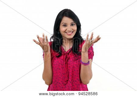 Happy Young Woman Gesturing An Open Hands Against White Background