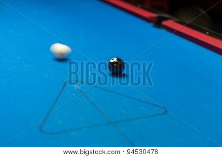 Pool Table, White Ball About To Hit Black