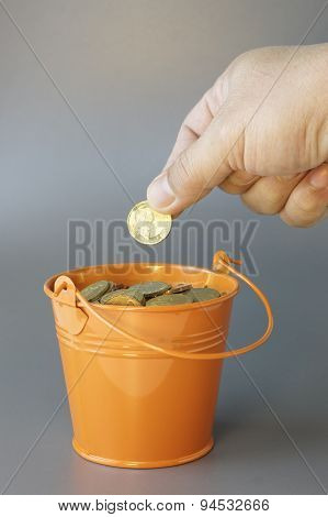 Gold Coins , Hand And Bucket - Financial Concept