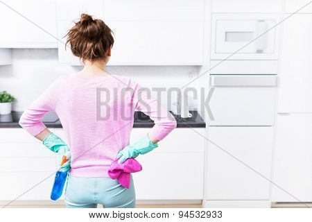 Woman cleaning kitchen