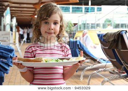Little Girl Standing And Holding Tray With Food On Cruise Liner Deck, Half Body