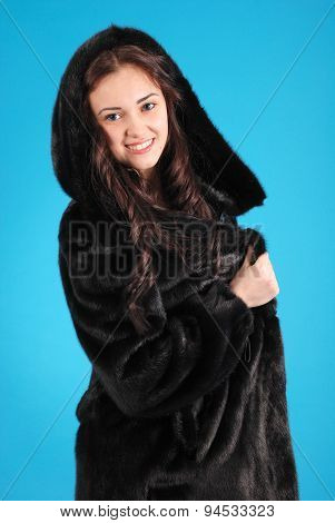 Beautiful Young Girl In Fur Coat