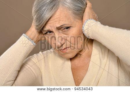 Thoughtful sad elderly woman