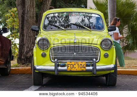 Havana, Cuba - February 5, 2008. Classic Fiat Parking Near Palm Trees.