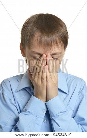 Young man praying head bowed