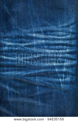Background Texture Of Blue Jeans With Pleats