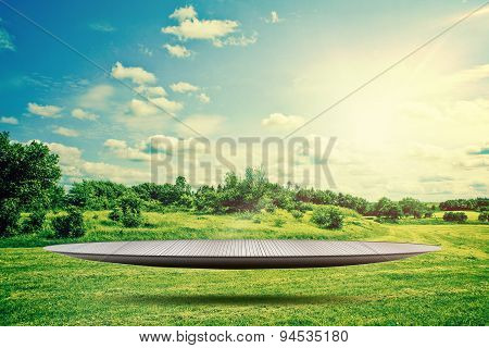 Stage Hovering In Landscape