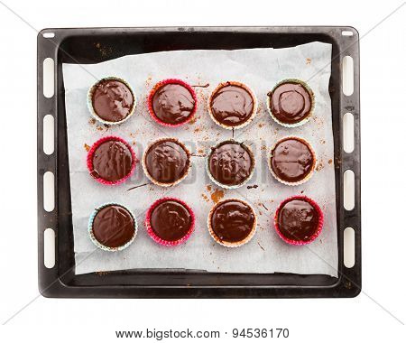 molten chocolate cakes on a baking tray, isolated on white