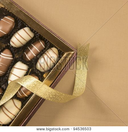 Box of premium date-chocolates. view from above.