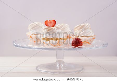 cake with white cream and fresh strawberries on stand