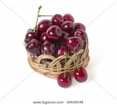 Ripe Cherry In A Wicker Basket. Isolated On White Background