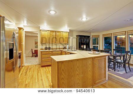 Traditional Kitchen With Hardwood Floor.