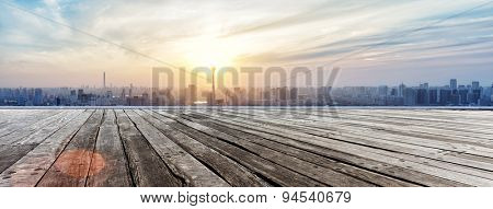 Panoramic skyline and buildings with empty wooden board