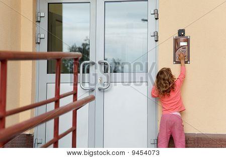 Little girl calling in on-door speakerphone what to get home.
