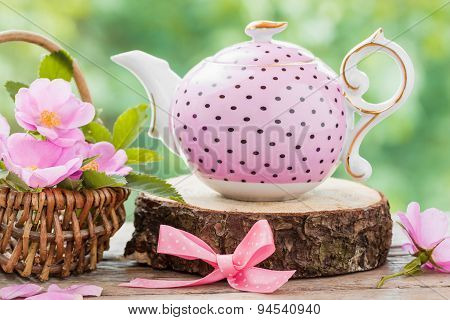 Tea Kettle And Basket With Pink Wild Roses. Wedding Or Birthday Still Life.