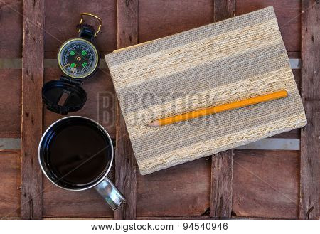 Cup Of Coffee With Compass And Notepad