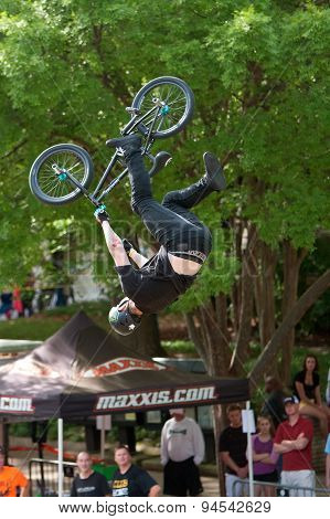 Pro Rider Goes Upside Down Performing BMX Trick In Competition