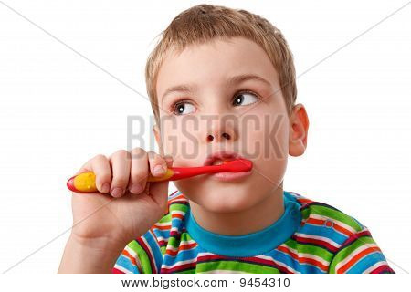 Portrait of boy with toothbrush on white background.