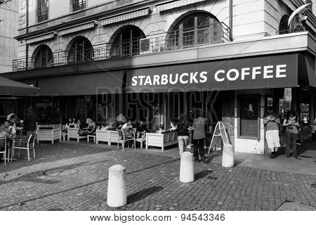 GENEVA - SEP 11: Starbucks cafe at city center on September 11, 2014 in Geneva, Switzerland. Starbucks is the largest coffeehouse company in the world, with more then 23000 stores
