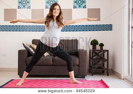 Happy Pregnant Mom Doing Yoga